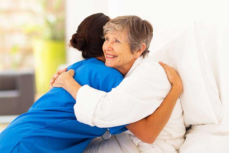 nurse hugging a patient